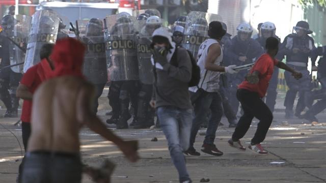 Embattled Brazilian president orders troops to restore order