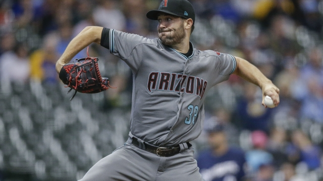 Ray gives up 2 hits in 7 innings, D-backs beat Brewers 4-0