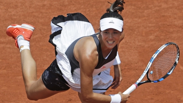 Defending champion Garbine Muguruza knocked out by Kristina Mladenovic