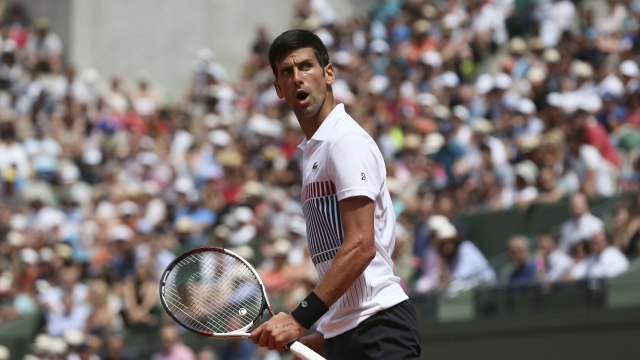 The Latest: Djokovic advances to 3rd round at French Open