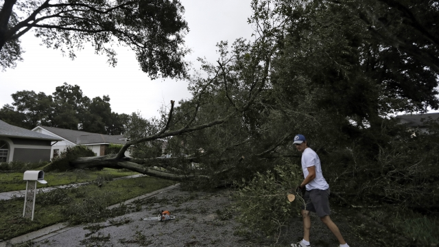 Now a tropical storm, Irma hits Florida with wind, flooding
