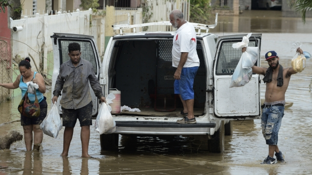 Powerless Puerto Rico's storm crisis deepens with dam threat