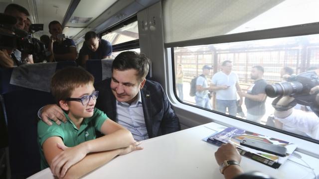 The Latest: rain to Ukraine held with Saakashvili aboard