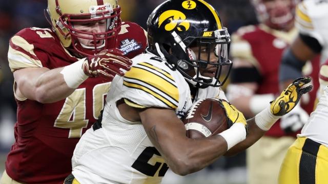 Iowa rallies to beat Boston College 27-20 in Pinstripe Bowl