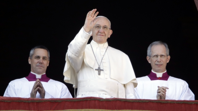 Pope, on Christmas Eve, says faith demands respect of immigrants