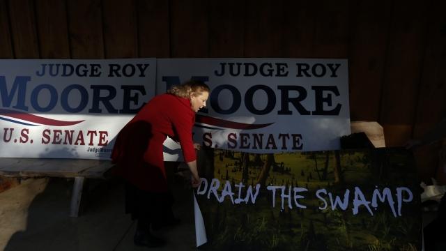 The Latest: Charles Barkley slams Moore, Bannon in Alabama