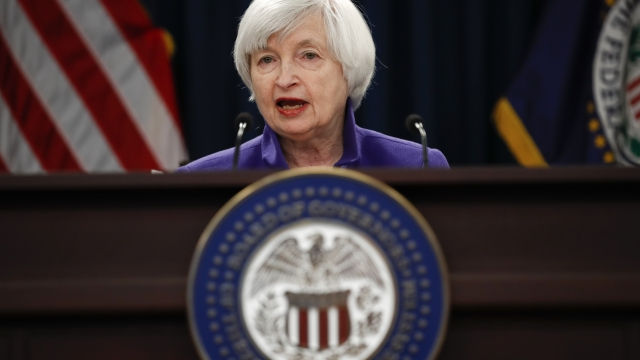 The Latest: Fed chair expects 'modest lift' from tax cuts
