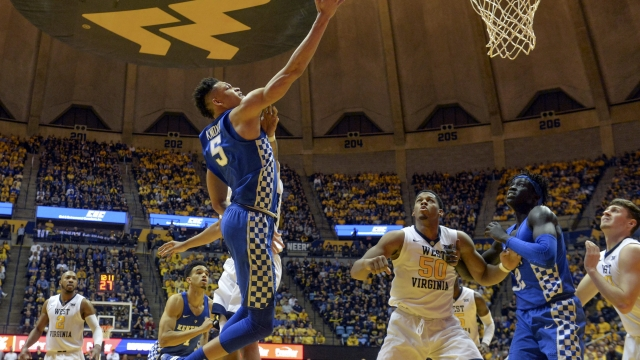 Knox scores season-high 34, Kentucky beats No. 7 WVU 83-76
