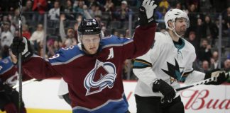 MacKinnon, Avs win 8th straight by holding off Sharks 5-3