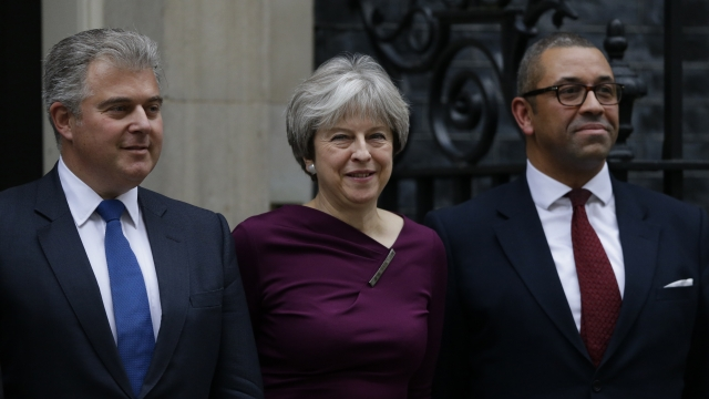 May plans Monday Cabinet reshuffle as divisive Brexit battles loom