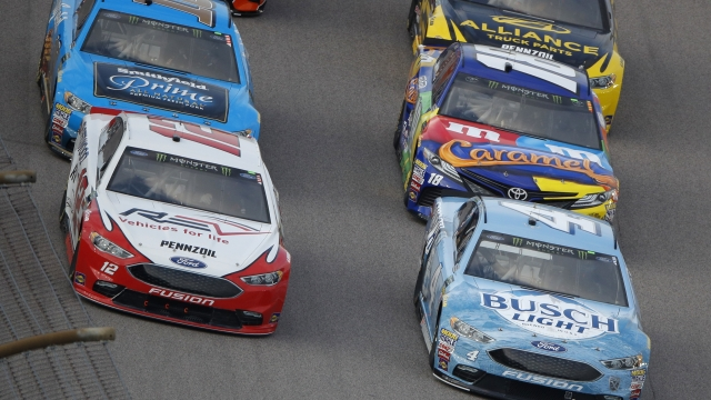 The Latest: Larson wins second stage at Kansas Speedway