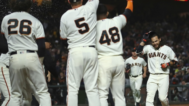 Crawford's 9th-inning HR gives Giants 1-0 win over Rockies