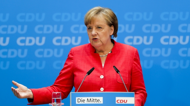 Merkel, allies avert collision for now in German migrant row