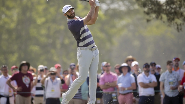 The Latest: Dustin Johnson in 4-way tie atop US Open