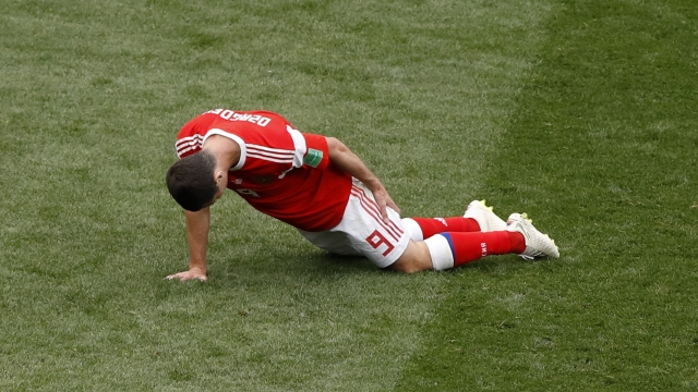 The Latest: Russia's Dzagoev rules self out of group games