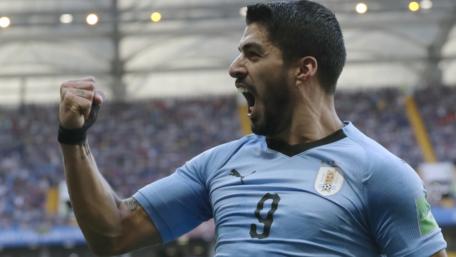 The Latest: Suarez strike has Uruguay up 1-0 at halftime