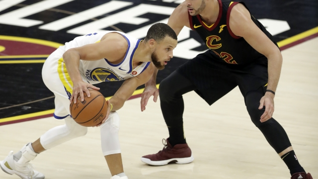 The Latest: Warriors rolling, have big lead over Cavaliers