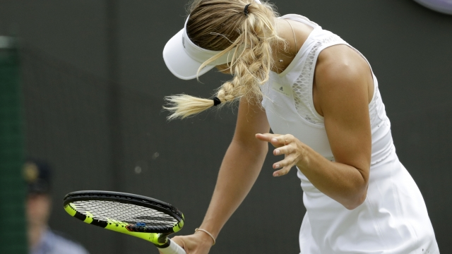 Bugs, 'lucky' foe send No. 2 seed Wozniacki out of Wimbledon