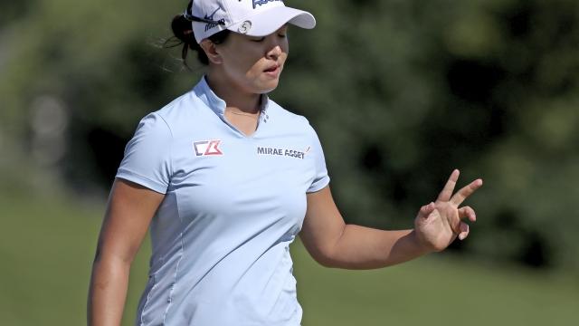 Kim shatters LPGA scoring records, wins by 9 shots