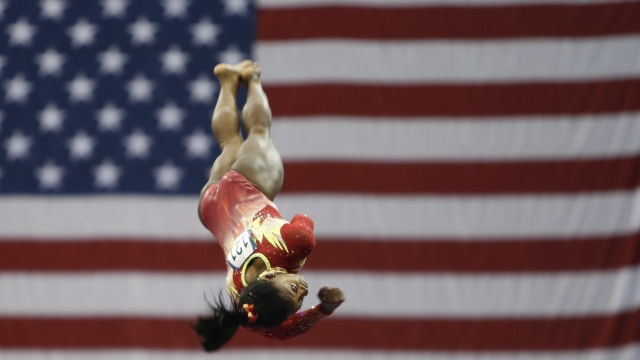 Olympic champ Biles triumphs in return to competition