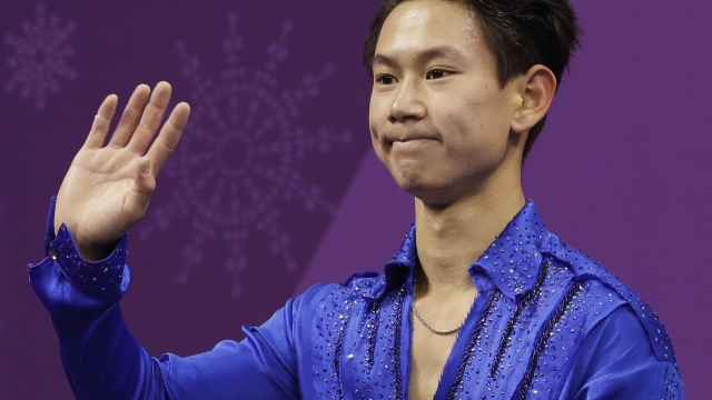 Suspect detained in killing of Olympic figure skating star