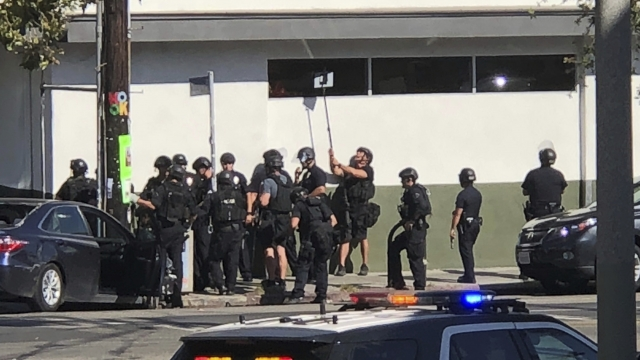 The Latest: Authorities say 1 killed in LA market standoff