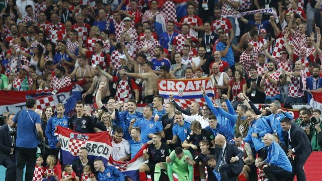 The Latest: Croatia, Sweden fined $50,000 for branded socks