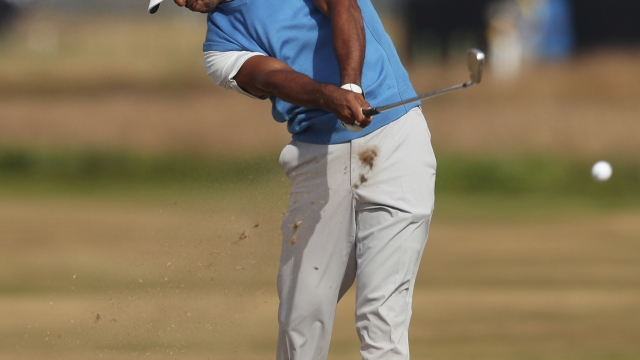 The Latest: Dustin Johnson's goal is making it to weekend