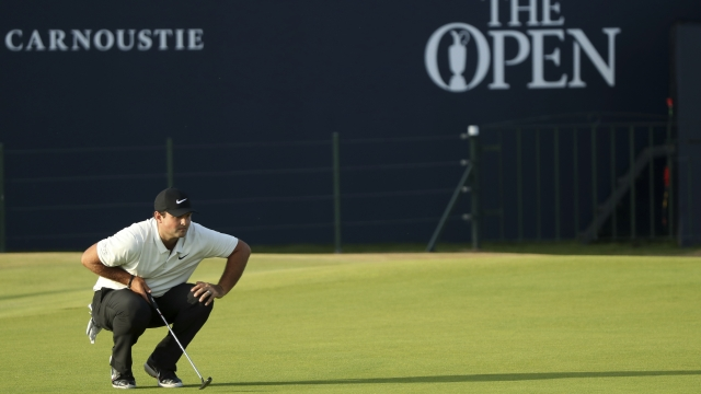The Latest: No wind, good scoring early in British Open