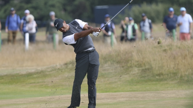 The Latest: Woods top of leaderboard at British Open