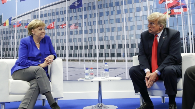 Trump rattles NATO, knocking its value, assailing Germany