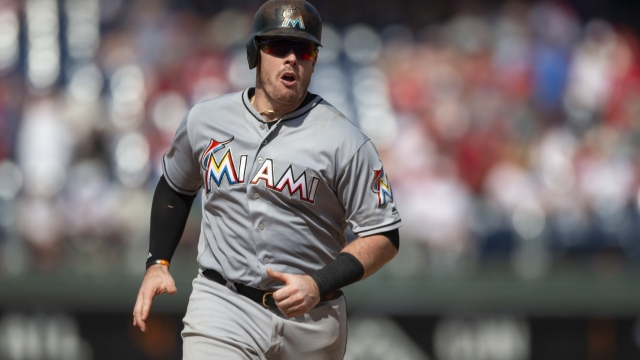 Phillies acquire 1B Bour, cash from Marlins for prospect
