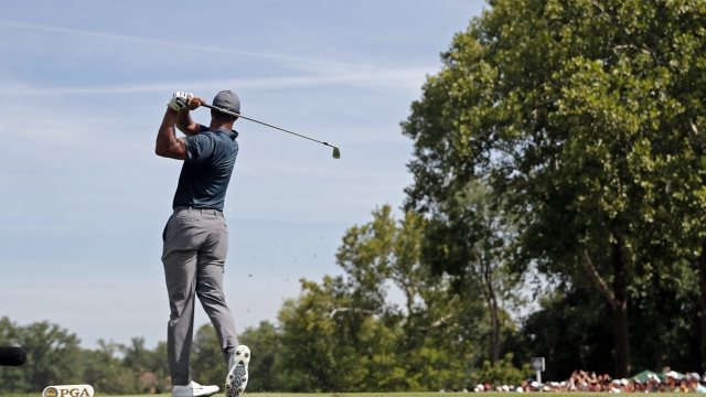 The Latest: Good scores available, ground to make up, at PGA
