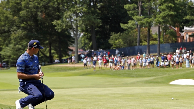 The Latest: Pressure mounting on leaders at PGA