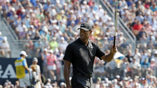 The Latest: Woods starts birdie-birdie at PGA Championship